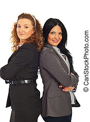 Happy business women with arms folded