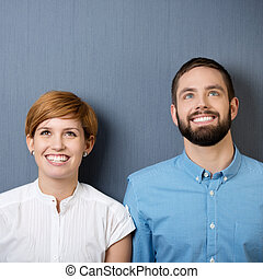 Happy Businessman And Businesswoman Looking Up