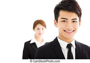 happy businessman and woman standing  in office