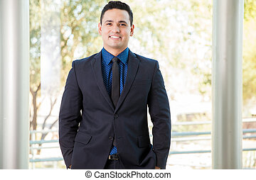 Happy businessman at work - Portrait of a handsome young ...