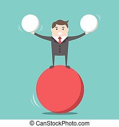 Happy businessman balancing