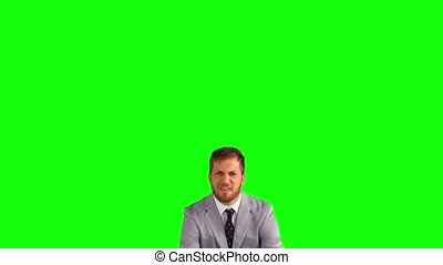 Happy businessman cheering and jumping on green screen in...