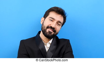 Happy businessman crossing his arms then smiling to the camera