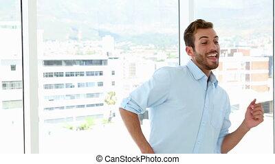 Happy businessman dancing