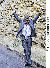 happy businessman dancing in the street