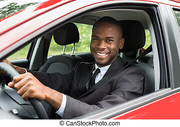 Happy Businessman Driving Car