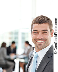 Happy businessman during a meeting with his team