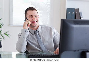 Happy businessman getting pleasant call
