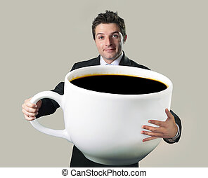 happy businessman holding funny huge oversized cup of black...