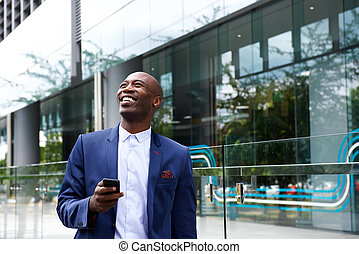 Happy businessman in the city