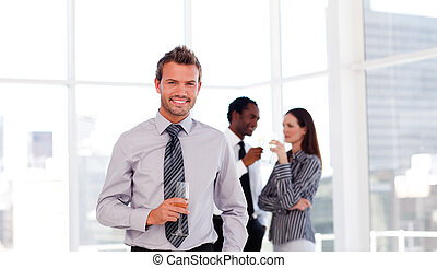 Happy businessman in the office with his team