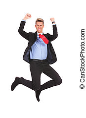 happy businessman jumping in air