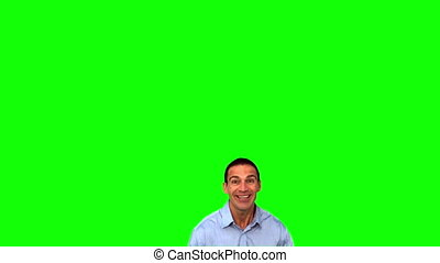 Happy businessman jumping on green screen in slow motion