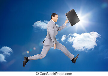 Happy businessman jumping with his
