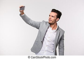 Happy businessman making selfie photo - Portrait of a happy...