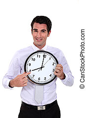 happy businessman pointing at clock