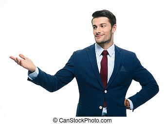 Happy businessman pointing away