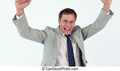 Happy businessman raising his fists in success against a...