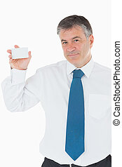 Happy businessman showing his card