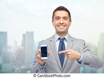 happy businessman showing smartphone screen