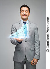 happy businessman showing virtual chart projection -...