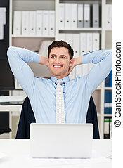 Happy businessman sitting daydreaming