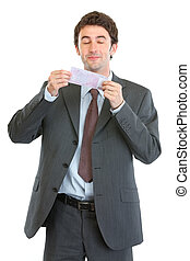 Happy businessman smiling 500 euros note