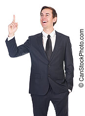 Happy businessman smiling and pointing finger
