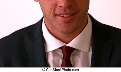 Happy businessman smiling at camer