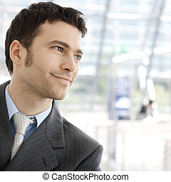Happy businessman smiling - Portrait of a happy young...