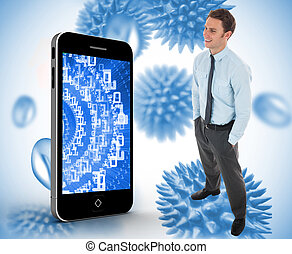Happy businessman standing with hands in pockets against blue virus cells