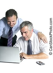 happy businessman team on computer good sales reports