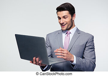 Happy businessman using laptop