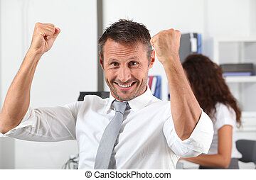 happy businessman with arms up