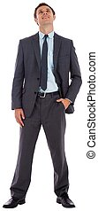 Happy businessman with hand in pocket
