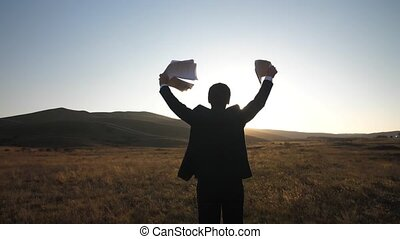 Happy businessman with papars in hands - Businessman waving...