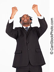 Happy businessman with raised arms