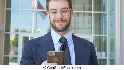 Happy businessman writing a text email or social media post...
