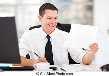 businessman writing report - happy businessman writing...