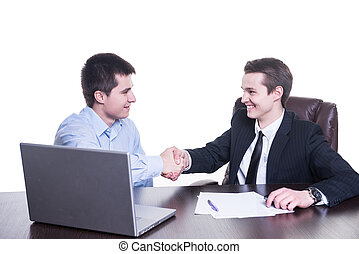 Happy businessmen shakes hands on business meeting