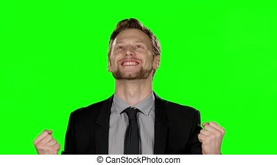 Happy businessmen smiling in camera. Green screen