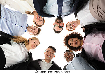 Happy Businesspeople Forming Huddle