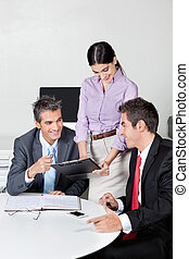 Happy Businesspeople In Meeting