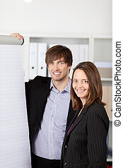 Happy Businesspeople With Flipchart