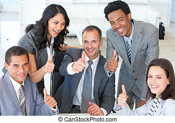 Happy businessteam with thumbs up in office - Happy ...