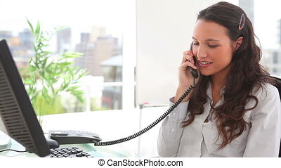 Happy businesswoman ending a call