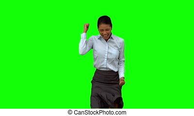 Happy businesswoman gesturing on gr