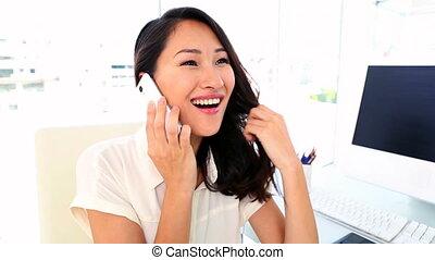 Happy businesswoman getting good ne