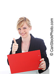 Happy businesswoman giving a thumbs up