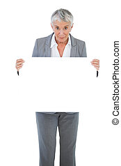 Happy businesswoman holding blank sign